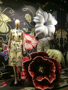 Beautiful, beautiful window from Gucci.  Looking like the prints floated off the dresses were formed into 3D.  This window is so over top p...