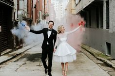 bride and groom with colour smoke bombs