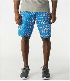 Make a bold statement in the stylish Nike Conversion Allover Print Shorts.  The neck-