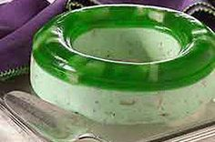This pretty lime gelatin mold has two layers. Both are studded with pears and one is made with cream cheese and pecans. Serve as a salad or dessert.