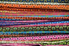 There is nothing more satisfying than looking at a stack of brightly coloured shweshwe!