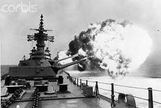 Off The Coast Of Vietnam --- Off the coast of Vietnam:The USS New Jersey, the Navy's only active battle ship, fires her nine 16 inch battery towards a target in Vietnam in this photo released by the Defense Dept. 5/9.  It was the first time since the ship's recommissioning that all nine guns were fired simultaneously.  The New Jersey returned to its home port of Long Beach, Calif., 5/5.  5/9/1969 --- Image by © Bettmann/CORBIS