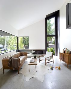 This project designed by D'Arcy Jones Architects gutted and re-built a classic split-level house from the early Photography by Sama Jim Canzian Home Interior Design, Interior And Exterior, Heated Concrete Floor, Living Area, Living Spaces, Living Room, Oak Plywood, Decoration, Furniture Design