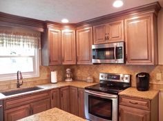 With this Hibshman Kitchen Remodel in Fishers, Indiana, we replaced and updated the kitchen cabinets, countertops, sink and flooring. L Shaped Kitchen Designs, U Shaped Kitchen, Modern Kitchen Design, New Kitchen Cabinets, Kitchen Redo, Kitchen Flooring, Kitchen Ideas, Tall Cabinets, Warm Kitchen