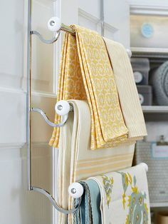 Use an over-the-door towel rack to keep table linens neat and ready for entertaining at a moment's notice. Over-the-door storage is not only convenient and accessible, but it also allows for extra space on the shelves and throughout the closet. Linen Storage, Door Storage, Storage Spaces, Smart Storage, Easy Storage, Kitchen Storage, Linen Closet Organization, Organization Hacks, Organizing Ideas