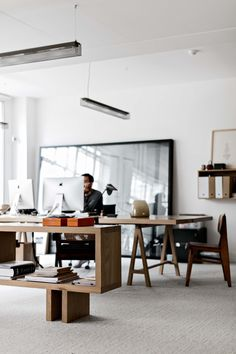 open office: minimal + mid-mod communal collaboration workshop areas.