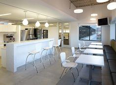 Break room area featuring Bingo chairs and stools and Conferencing Solutions tables. #Clean #Modern #Breakroom #White #Office #Furniture #Lounge