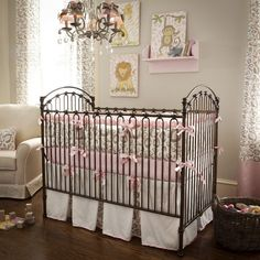 Baby Nursery Celebrities' Baby Nursery Room You Can Get Inspired from: Elegant Baby Nursery With Iron Crib Pink Ribbon Accesories Crystal Chandelier Cute Animal Painting Wall Decoration Rattan Basket Laminated Wooden Floor