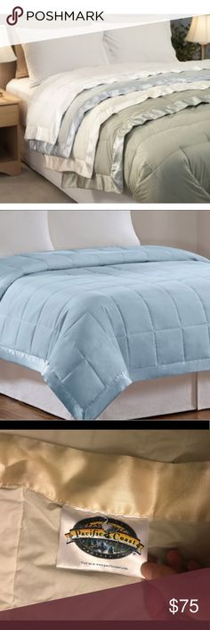 Comforter Pacific coast down blanket. Generously sized blanket gives light warmth that's great for spring, summer or any time of the year. Filled with fluffy down & finished with shiny satin border. Perfect for various decor. Only selling because I purchased a new bed & comforter. Great condition pacific coast Other