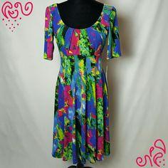 "Maggy London colorful sundress size 8 Beautifully colorful Maggy L dress Size 8 Brand new Material pictured  Bust- 32"" Waist- 30"" Length- 40"" Sleeve- 11"" Maggy London Dresses"