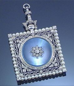 LADY'S ENAMEL, PEARL AND DIAMOND FOB WATCH, CIRCA 1910. Applied to the obverse with a circular blue guilloché Enamel plaque within a square openwork millegrain frame embellished with Seed Pearls, rose- and single-cut Diamonds, the reverse with circular dial and Arabic numerals, to a trace link chain, fitted case by Harvey & Gore