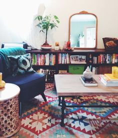 It's amazing what a patternful rug can do to warm up a space--this studio apartment was converted from a garage!