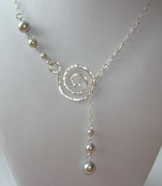 Here's a new take on the lariat style ~ a handmade sterling silver, hammered swirl pendant with pretty graduated light grey Swarovski Crystal Pearls. Necklace is down to the swirl pendant; pendant plus the pearls dangling are an additional 2 (approx. Diy Jewelry Necklace, Necklace Designs, Handmade Necklaces, Silver Jewelry, Handmade Jewelry, Beaded Necklace, Diy Necklace With Pendant, Bridal Necklace, Silver Rings