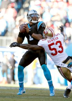 CHARLOTTE, NC - JANUARY 12: Cam Newton #1 of the Carolina Panthers is sacked by NaVorro Bowman #53 of the San Francisco 49ers in the third quarter during the NFC Divisional Playoff Game at Bank of America Stadium on January 12, 2014 in Charlotte, North Carolina. (Photo by Kevin C. Cox/Getty Images)