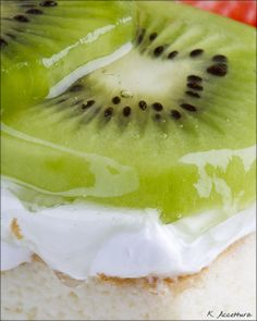 Angel food cake or any white cake, whipped topping  glazed kiwi slices.  for glaze..  Combine 1/4 c. apricot preserves  1 TBSP water in small saucepan and heat until preserves melt. Cool the glaze slightly, stirring occasionally. Spoon glaze over kiwi fruit. Enjoy!