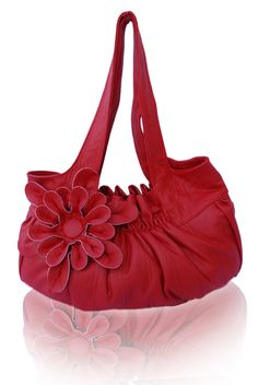 Red leather purse with a flower pop.