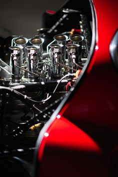 Intake trumpets on the engine of an Alfa Romeo T33 Stradale