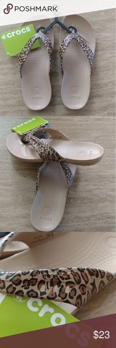 Brand New. Leopard Print Flip Flops Crocs Brand New, never worn Leopard Print Flip Flops Crocs, these are real light weight and comfortable. Size is 7 but it can fit 7.5. CROCS Shoes Slippers