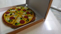 side view of felt food pizza