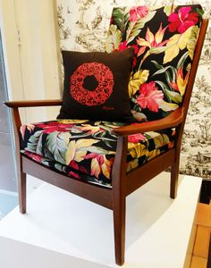 This chair is upholstered with our nubby barkcloth called Pau Hana. It was made by one of our customers. It comes in a natural and black background. Find more here: BarkclothHawaii.com