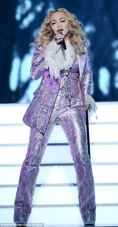 The Revolution: The 57-year-old Material Girl paid homage to the Purple One by donning a Gucci lavender paisley suit and ruffled blouse and belting Nothing Compares 2 U onstage the T-Mobile Arena