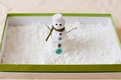 Indoor snowman made with cornstarch and shaving cream - fun rainy day activity for the kids!
