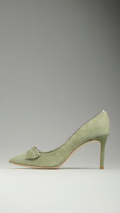 Green suede court shoes featuring bow detail on the cap toe, silver trims, heel height 3.1'', leather sole, 100% suede.