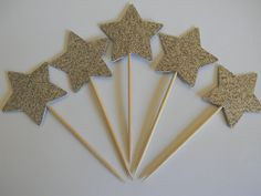 "24 Silver Glitter 1 3/8"" inch stars star cupcake toppers food picks birthday party décor shower supplies. 24 Silver glitter cupcake toppers-Approx. 3 inches tall-Star is 1 3/8"" inch in size-Made from glitter card stock."