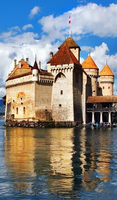 The well-known palace museum Shillon on coast of lake Leman in Switzerland   |   Amazing Photography Of Cities and Famous Landmarks From Around The World