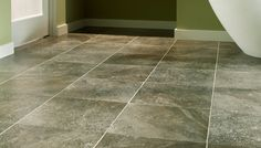 """LVT (Luxury vinyl tile) by Mannington can be """"floating"""" or cemented in place. Doesn't look like your mother's vinyl tile . . ."""