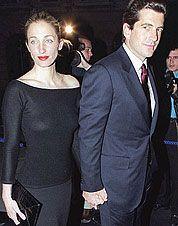 Timeless style: John, Jr. and Carolyn Kennedy hold hands at a party celebrating the opening of a Ralph Lauren store in London, May 4, 1999.
