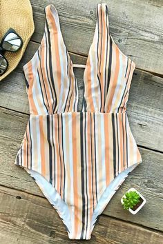 2fb892be2fc43 Put on this swimsuit when you are attending a surf camp along the  glittering coast of Portugal. Product Code  Details  Stripe design With  padding bra ...