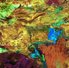 """The various hues of this abstract scene represent the different landscapes present in Dasht-e Kavir, or the Great Salt Desert, of northern Iran. The sparsely populated desert is named after its many salt marshes (""""kavir"""" means salt marsh in Persian). The Great Salt Desert is also home to dry streambeds, plateaus and mud flats, covering almost 30,000 square miles of the Iranian Plateau."""