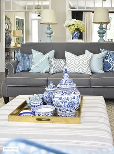 Style your coffee table with a clustered grouping of blue and white ginger jars and accessories. Use the same idea for any monochromatic display. Living Room On A Budget, Home Living Room, Living Room Furniture, Living Room Decor, Condo Living, Bedroom Decor, Black Interior Doors, My Ideal Home, Coffee Table Styling