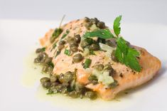 Baked Salmon with Lemon Caper Butter - May in the Northwest means the start of salmon season and as a result wild salmon is available pretty much everywhere.