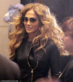 9bb1e5f033f Jennifer Lopez gets mobbed again by fans outside her hotel as she pulls off  wearing sunglasses at night