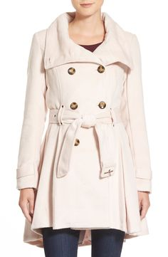 A flattering fit-and-flare coat in blush that will add a touch of femininity to a cozy look.