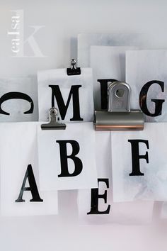 Use large paper clips (orwhatyoucallthem), print out individual alphabets to create personal art. Hang them on a silk ribbon.