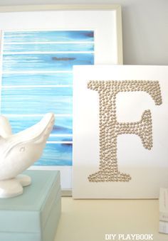 """Create unique wall art with just a canvas and some thumb tacks. Would be cute for initials, a date, or even the word """"LOVE""""!"""