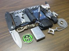 Every Day Carry Submitted By: AlexB Glock 19 Large Sebenza 21 with Ebony Inlays - Purchase on Amazon TAD Lenslight Mini Steel Flame Executive Sledge Bracelet Steel Flame Killbox Steel Flame Key Hook Munroe Knives Mega Dangler iPhone 4
