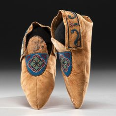 Plains Cree Beaded Hide Moccasins thread-sewn and beaded using small glass beads in colors of pony trader blue, rose, clear, greasy yellow, and light green, length 9.5 in. fourth quarter 19th century Condition: Insignificant bead loss.
