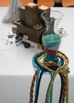 Handfasting cords surround blended sand by the water fountain on the head table. Handfasting Cords and colors meaning Plan Your Wedding, Wedding Planning, Dream Wedding, Wedding Day, Wedding Dreams, Wedding Bells, Ribbon In The Sky, Wiccan Wedding, Handfasting Cords