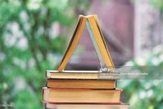 Build knowledge through continuing education. A stack of books resembling a building. Stack Of Books, Continuing Education, Creative Photography, Royalty Free Images, Knowledge, Community, Stock Photos, Fine Art, Building
