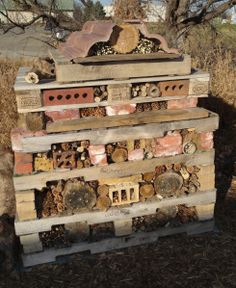 """Insect hotel for the Garden. Attract beneficial insects and native bees by building a habitat. This """"Insect hotel"""" was made from pallets and filled with a variety of natural and man made materials: bricks, stones, pine cones, milkweed pods, straw, logs with holes bored into them, scrap lumber, bamboo and other hollow-stemmed plants... even cardboard egg cartons. This is a fun family project - make what you want. Use recycled materials to benefit pollinators. Put it in your garden and…"""