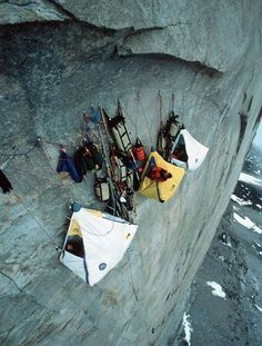 "Setting up camp for the night on a sheer cliff so you can get right back at it and finish your climb tomorrow.... Talk about the ""outdoors type""."