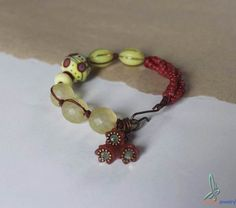 Bohemian, fashion bracelet in yellow and red with lampwork glass beads from Esfera Jewelry