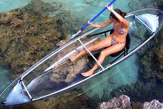 Transparent Canoe. Love this but I'd be afraid I'd see a shark!