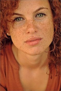 breathtakingly pretty green eyes, perfect freckles and firered hair and crackopenning lips.