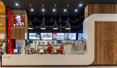 Find inspiration in the Corian Solid Surface photo gallery. From Seamless benchtops to facade cladding to thermoformed counters to backlit and engraved. Mall Design, Store Design, Kfc Restaurant, Burger Places, Counter Design, Restaurant Interior Design, Food Court, Corian, Luxury Homes Interior
