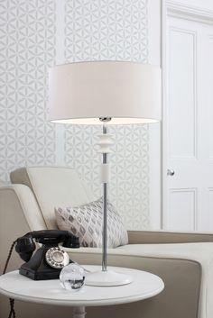 Camus Table Lamp  Available in three finishes this 1950's inspired table lamp is made from hand painted turned wood with metal detail.